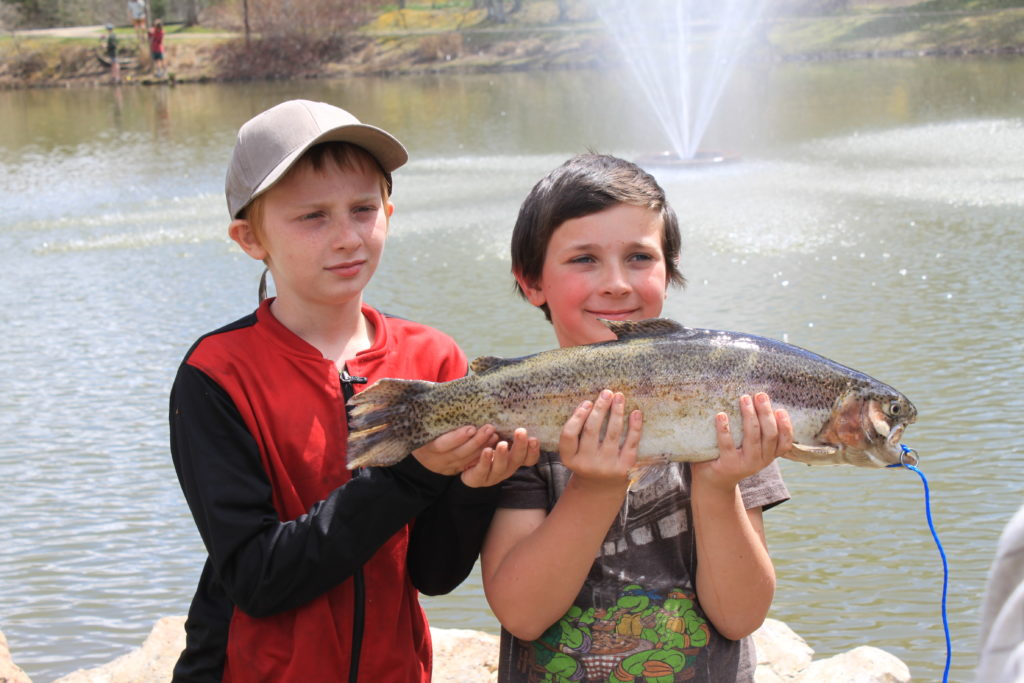 kids with trophy trout