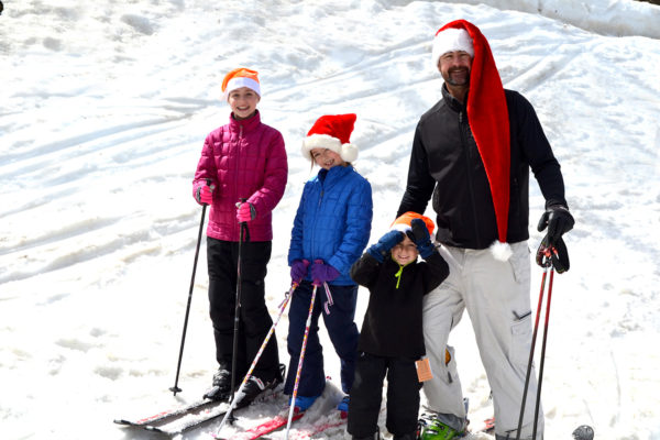 family skiing at Christmas