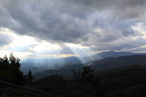 Light breaks through clouds over the Blue Ridge