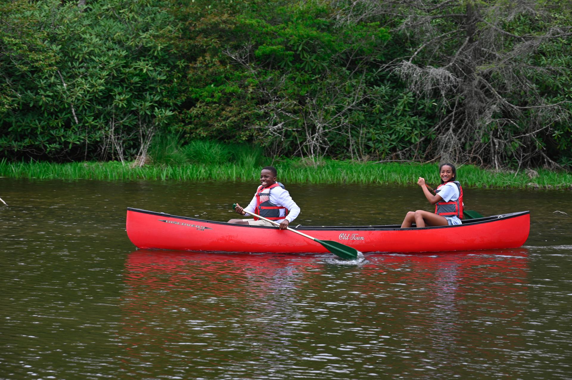 teenagers kayaking on price lake