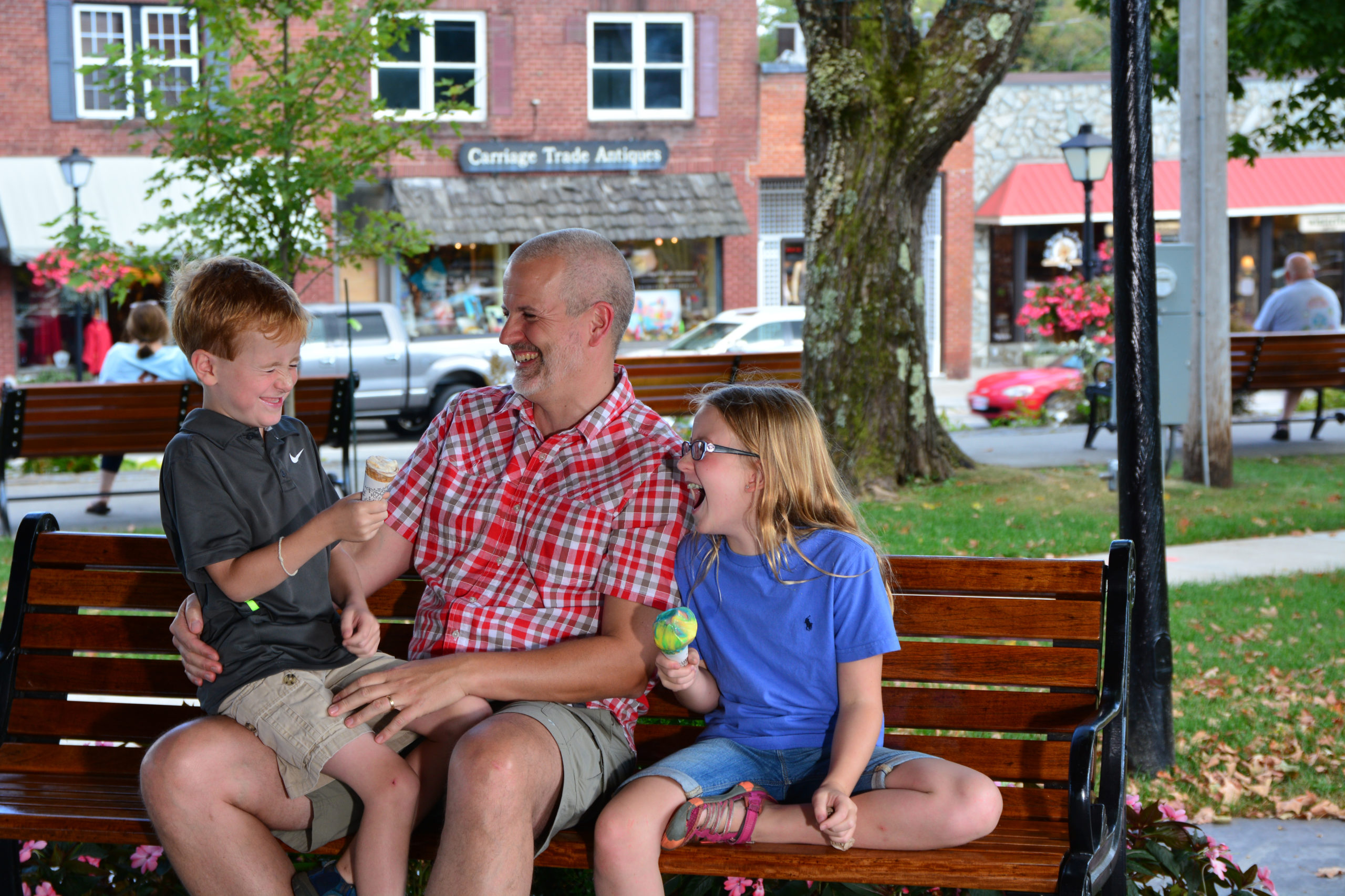 family eating ice cream in downtown blowing rock