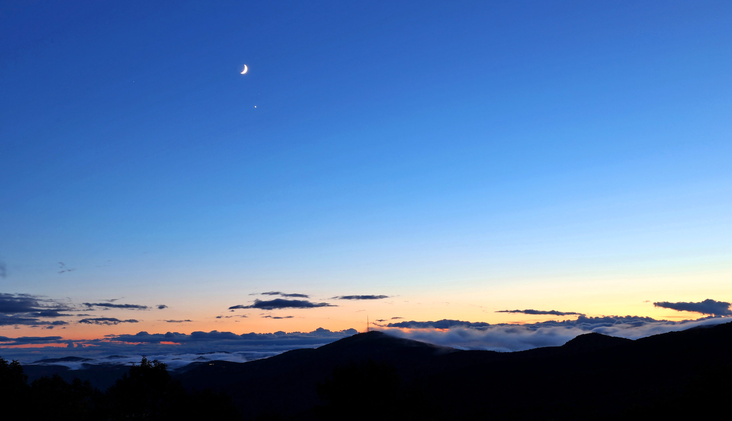 Moon and venus over Blue Ridge Mountains near blowing Rock